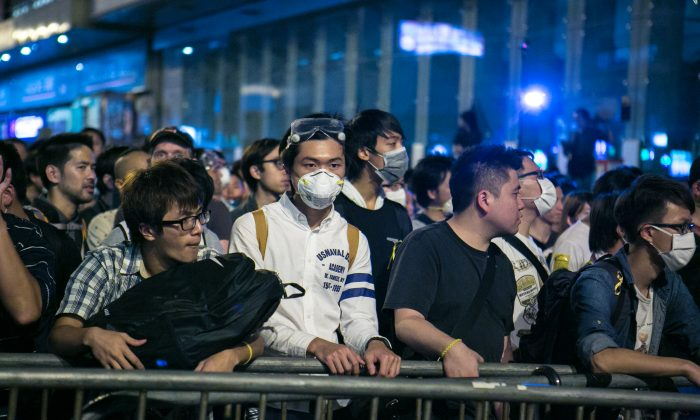 Pro-democracy protesters successfully occupy a portion of Argyle Street after repeatedly failed attempts in Mong Kok, Hong Kong,  on Oct. 18, 2014. (Benjamin Chasteen/Epoch Times)