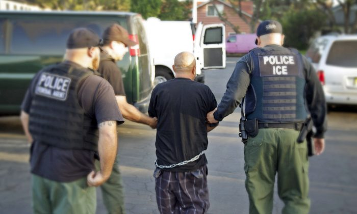 U.S. Bureau of Immigration and Customs Enforcement (ICE), agents arrest a person in an  immigration sweep in Ontario, Calif.  on Oct. 14, 2014. (AP Photo/U.S. Bureau of Immigration and Customs Enforcement)