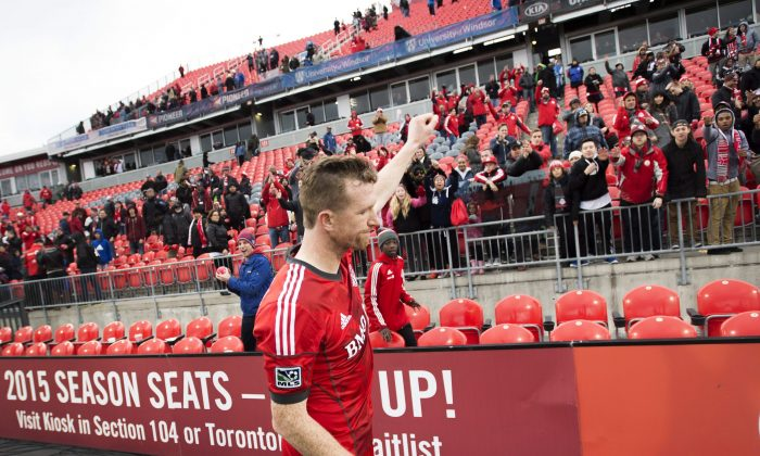 Toronto FC captain Steven Caldwell acknowledges the crowd following the club's final home game of the MLS regular season against the Montreal Impact in Toronto on Sat. Oct. 18, 2014. (The Canadian Press/Darren Calabrese)