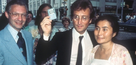 Immigration lawyer Leon Wildes (L) with John Lennon (C) and Yoko Ono (R). Lennon holds up his green card in circa summer of 1976, despite the Nixon administration's efforts to deport him. (Courtesy of Wildes & Weinberg P.C)