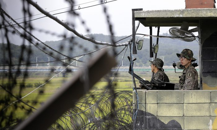 South Korean army soldiers stand guard at a military checkpoint on Sept. 17, 2014, at the Imjingak Pavilion near the border village of Panmunjom, which has separated the two Koreas since the Korean War, in Paju, South Korea. (AP Photo/Ahn Young-joon)