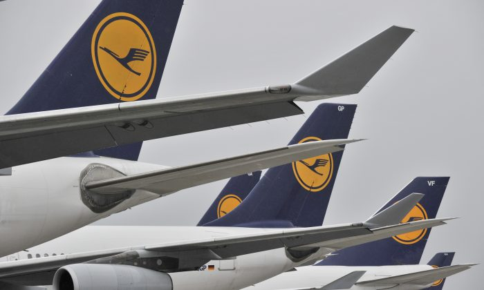 Lufthansa planes stand at the Frankfurt Rhein-Main airport in Frankfurt Germany. (AP Photo/dpa, Boris Roessler)