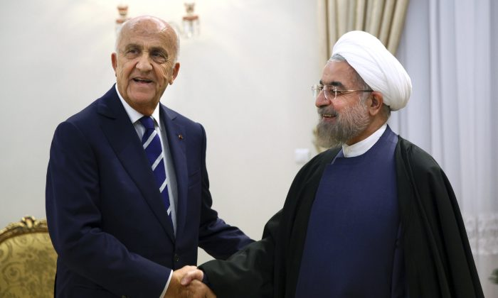 "Lebanese Defense Minister Samir Moqbel (L) shakes hands with Iran's President Hassan Rouhani at his office in Tehran, Iran, Sunday, Oct. 19, 2014. Moqbel also met other Iranian officials including Ali Shamkhani, Secretary of the Supreme National Security Council. ""Iran is ready to transfer its experience in order to improve security in Lebanon and the region, and to combat terrorists,"" Shamkhani said during a meeting with Moqbel in Tehran on Sunday. (AP Photo/Ebrahim Noroozi)"