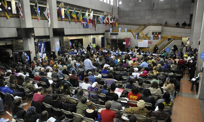 Detroit residents address a panel, which includes members from the United Nations, during a UN Fact-Finding Detroit Town Hall Meeting, Sunday, Oct. 19, 2014, at Wayne County Community College in Detroit.  The residents are explaining how the recent water shutoffs to their homes affect their lives. (AP Photo/Detroit News, Jose Juarez)