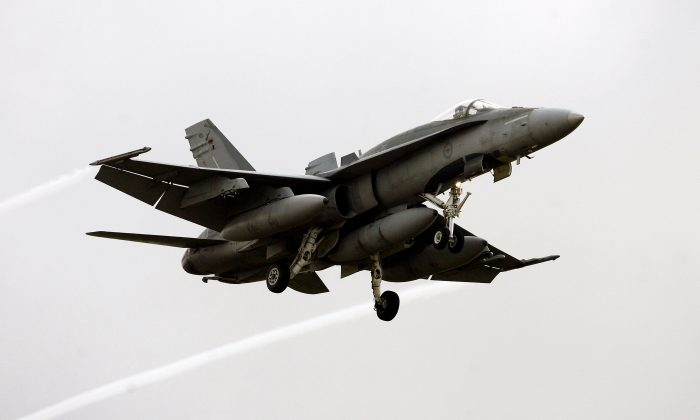 An F18 Hornet of the Canadian air force prepares to land at the Trapani Birgi air base in the southern island of Sicily on March 18, 2011. (Marcello Paternostro/AFP/Getty Images)