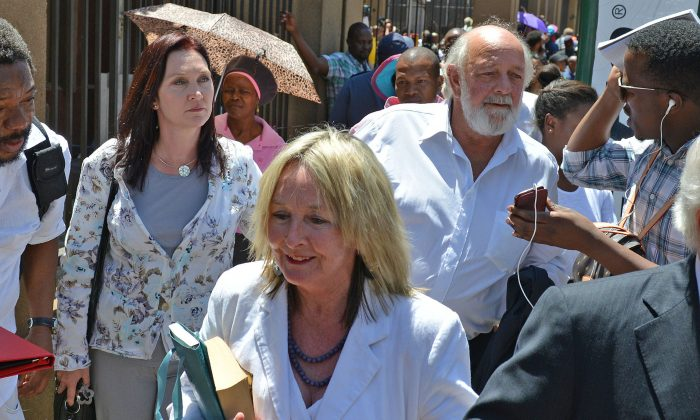 Parents of the late Reeva Steenkamp, June, front, and Barry back, leave court in Pretoria, South Africa, after Oscar Pistorius was handed down a five-year sentence by judge Thokozile Masipais for killing his girlfriend Steenkamp last year.  (AP Photo/Antoine de Ras, Independent Newspapers)