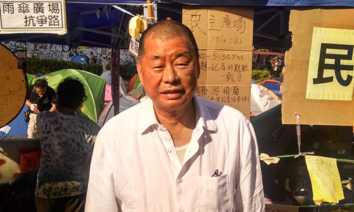Jimmy Lai stands outside the shelter he sometimes uses in the Occupy Central encampment in the neighborhood of Admiralty, in Hong Kong on Oct. 20, 2014. (Matthew Robertson/Epoch Times Staff)