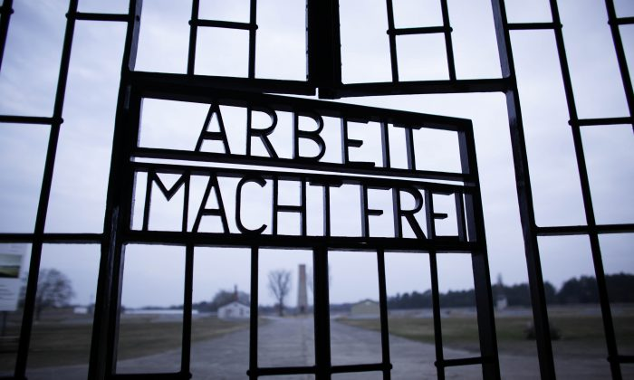 """This photo shows the words """"Arbeit Macht Frei"""" (Work Sets You Free) at the main entrance of the Sachsenhausen Nazi concentration camp on the international Holocaust remembrance day in Oranienburg, Germany. (Markus Schreiber/AP Photo)"""