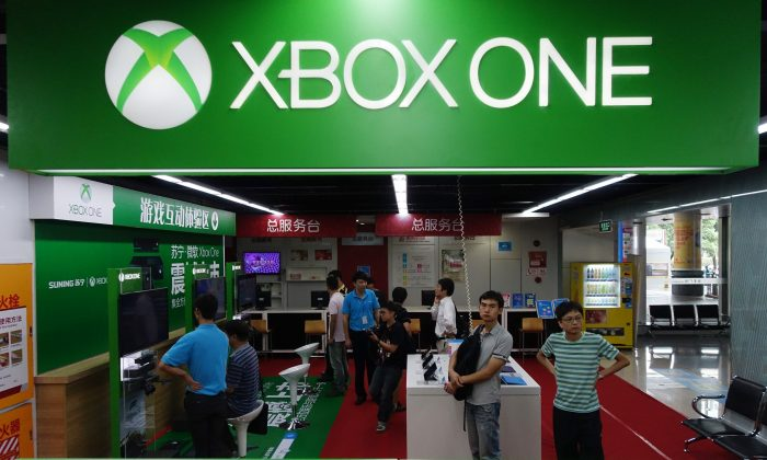Customers wait insde the Microsoft's Xbox One booth in Shanghai on Sept. 29, 2014. The Xbox One launched in China, the first games console officially released on the mainland after Beijing lifted a ban on the devices, which it had imposed in 2000.( Johannes Eisele/AFP/Getty Images)