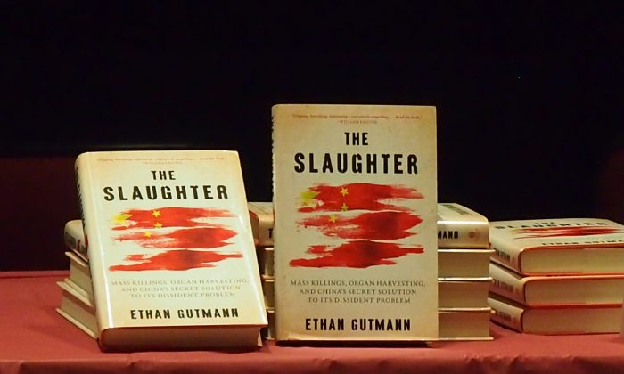 Copies of The Slaughter: Mass Killings, Organ Harvesting, and China's Secret Solution to Its Dissident Problem are displayed at a discussion forum on Oct. 20 at Concordia University in Montreal. The book sheds new light on the state-orchestrated forced extraction of vital organs from prisoners of conscience in China, who include Falun Gong practitioners, Tibetans, Uyghurs, and House Christians. (Nathalie Dieul/Epoch Times)