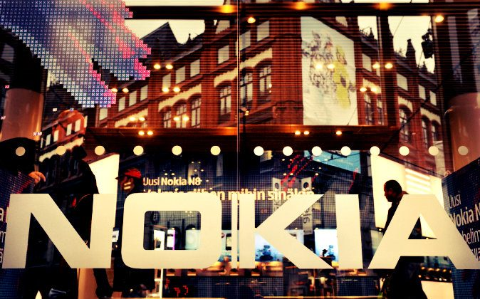A picture taken on Oct. 21, 2010 shows the logo of Finland's mobile phone maker Nokia on the window of Nokia flagship store in Helsinki. (Markku Ulander/AFP/Getty Images;effects added by Epoch Times)