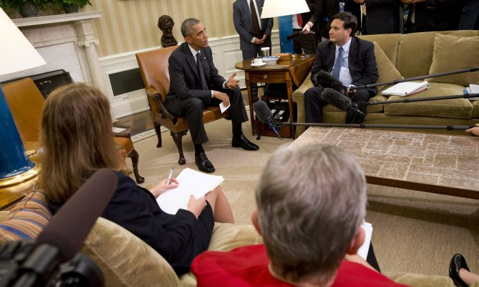 President Barack Obama, back left, with Ebola coordinator Ron Klain and members of his team coordinating the government's Ebola response, speak to the media after their meeting in the Oval Office of the White House, Wednesday, Oct. 22, 2014, in Washington. At front left is Sylvia Burwell, Secretary of Health and Human Services, and Ambassador Nancy Powell, Special Coordinator for Ebola Response Unit. (AP Photo/Jacquelyn Martin)