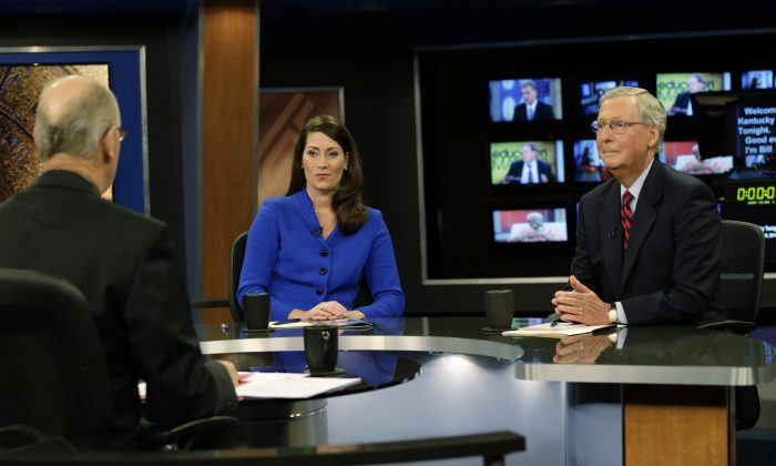 "Senate Minority Leader Mitch McConnell of Ky. (R) and his Democratic Senate opponent, Kentucky Secretary of State Alison Lundergan Grimes, rehearsed with host Bill Goodman before their appearance on ""Kentucky Tonight"" television broadcast live from KET studios in Lexington, Ky., on Oct. 13, 2014. Struggling to preserve their Senate majority, Democrats are attacking Republicans over Medicare and Social Security in Louisiana, spending cuts in Arkansas, off-shore jobs in New Hampshire and women's issues in Colorado. (AP Photo/The Lexington Herald-Leader, Pablo Alcala)"