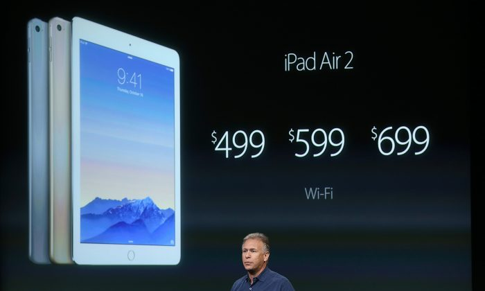 Apple Senior Vice President of Worldwide Marketing Phil Schiller announces the new iPad Air 2 during a special event  in Cupertino, Calif. on Oct. 16, 2014. (Justin Sullivan/Getty Images)