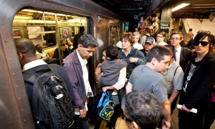 People exit the New York City subway at Time Square in this 2013 file photo. (Epoch Times)