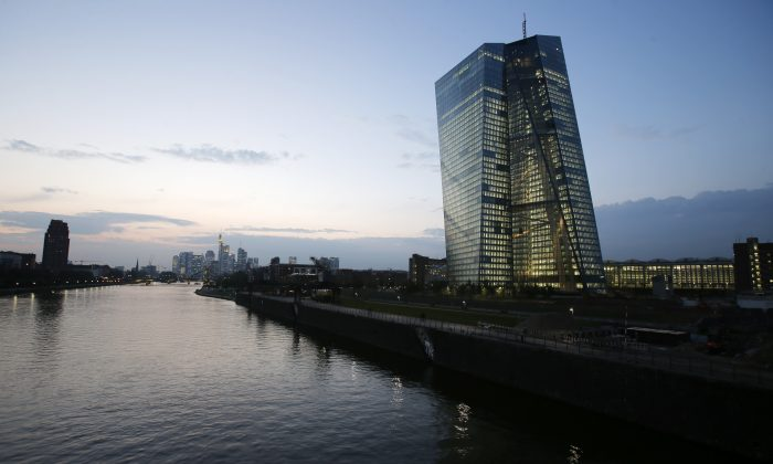 FILE - The new headquarters of the European Central Bank (ECB), building at right, under construction on the water front of the River Main in Frankfurt, Germany, in this Sept. 24,2014 file photo. The European Central Bank said Sunday Oct. 26, 2014 that 13 of Europe's 130 biggest banks have flunked an in-depth review of their finances and must increase their capital buffers against losses by 10 billion euros ($12.5 billion). (AP Photo/Michael Probst, File)