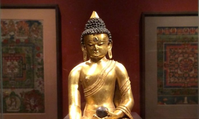 A Medicine Buddha statue at the Rubin Museum of Art in Manhattan, Aug. 8, 2014. The Medicine Buddha is the central figure of Tibetan medicine. He sets the supreme example of compassion that all Tibetan doctors try to show their patients. (June Fakkert/Epoch Times)