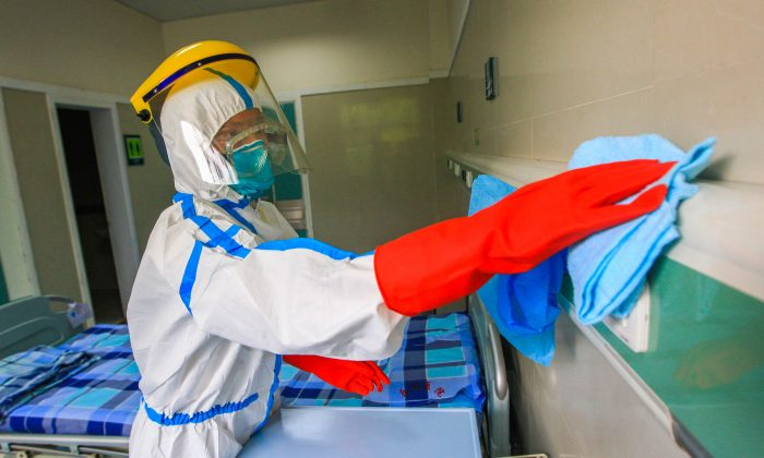 Medical staff performs an Ebola-preventing exercise on September 11, 2014 in Foshan, Guangdong province of China. China tests body temperature of participants of China's largest trade expo Canton Fair in Guangzhou on Oct. 23, 2014. (ChinaFotoPress/Getty Images)