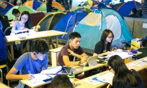 Hong Kong Police Arrest Protesters for Using Social Media to Organize