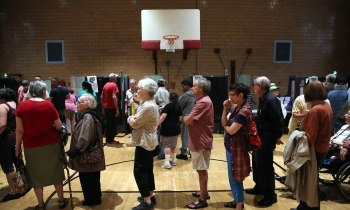 Voters queue to cast their ballots in the mayoral primary election Manhattan on Sept. 10, 2013. (John Moore/Getty Images)