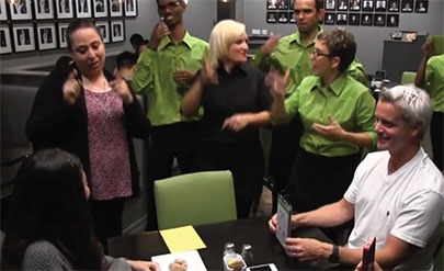 Deaf staff and restaurant manager Rachel Shemuel (far left) converse with patrons through sign language. (Courtesy Signs Restaurant & Bar)