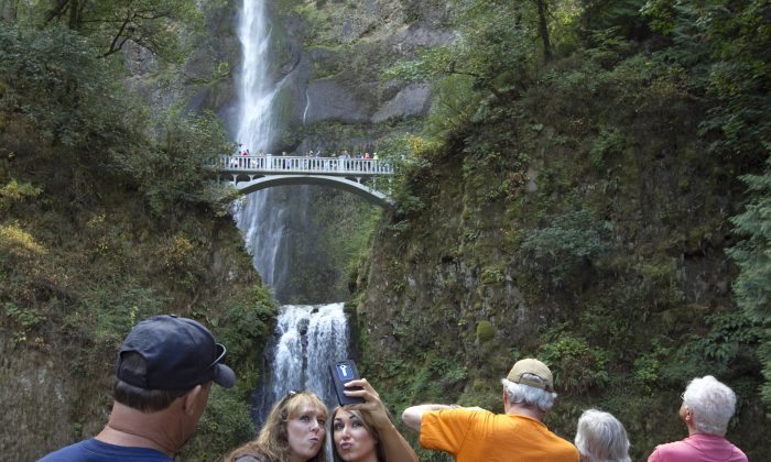 Visitors take a selfie in the Columbia River Gorge National Scenic Area in Multnomah Falls, Ore., on Sept. 26, 2014. (Natalie Behring/Getty Images)