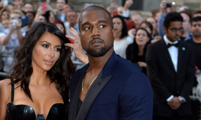 Kim Kardashian and Kanye West attend the GQ Men of the Year awards at The Royal Opera House on September 2, 2014 in London, England. (Photo by Anthony Harvey/Getty Images)