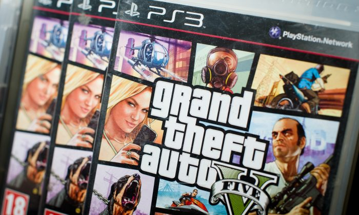 An article stating Rockstar has confirmed the next Grand Theft Auto (GTA 6) will take place in Chicago is bogus. Close view of the packaging of the console game Grand Theft Auto 5 at the midnight opening of the HMV music store in central London on September 17, 2013. (Leon Neal/AFP/Getty Images)
