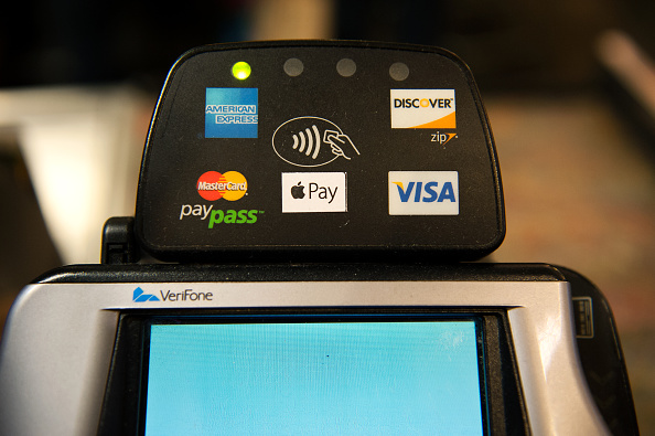 Apple Pay is promoted on signs placed at the cash register of Whole Foods in Columbus Circle on Oct.20, 2014 in New York, NY. (Bryan Thomas/Getty Images)