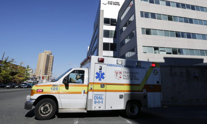 An ambulance drives near University Hospital of Newark in Newark, N.J. on Oct. 27, 2014. (Mel Evans/AP Photo)