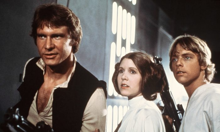 "Harrison Ford (Han Solo), Carrie Fisher (Princess Leia), and Mark Hamill (Luke Skywalker) in a scene from the 1977 ""Star Wars"" movie released by 20th Century-Fox. (AP Photo/20th Century-Fox Film Corporation, File)"