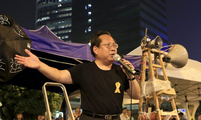 Albert Ho, speaking through a megaphone at the Admiralty occupied zone protest site on Oct. 14. The pan democrats, like Ho, have largely been on the sidelines supporting the student-led umbrella movement. (Yu Kong/Epoch Times)