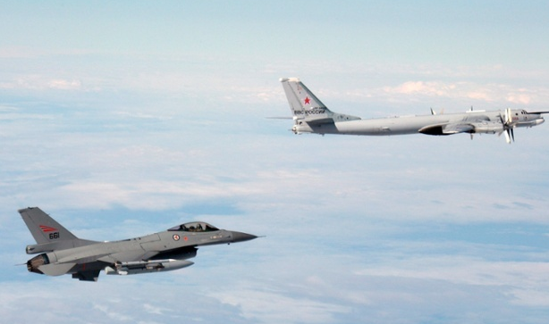 A Norwegian F-16 shadows a Russian air force Tupolev Tu-95 in a photograph released by the Norwegian air force.
