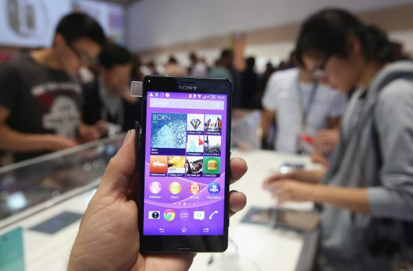 A photographer holds a Sony Xperia Z3 smartphone in Berlin, Germany. An infected file in the smartphones was found to relay data to China. (Sean Gallup/Getty Images)
