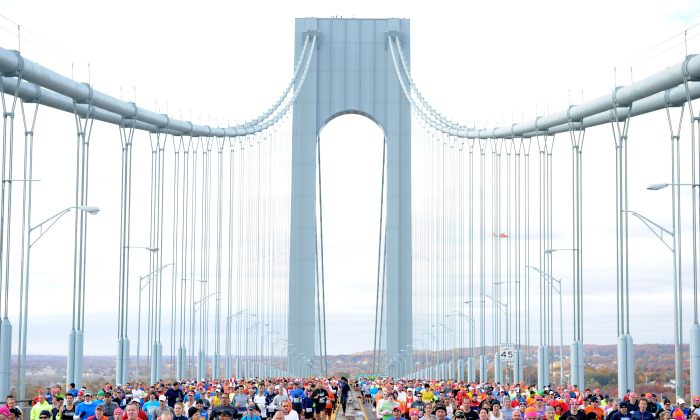 Runners cross the Verrazano-Narrows Bridge at the start of the New York City Marathon on November 3, 2013 in the Brooklyn borough of New York City. (Maddie Meyer/Getty Images)