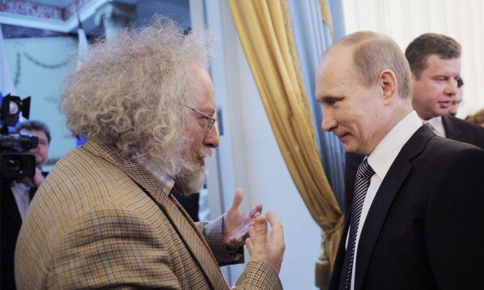 Russia's Prime Minister Vladimir Putin (R) speaks with Ekho Moskvy radio's editor-in-chief Alexei Venediktov (L) during an awarding ceremony in Moscow, on Jan. 13, 2012. (Yana Lapikova/Ria-Novosti/AFP/Getty Images)
