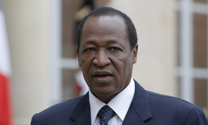 Burkina Faso President Blaise Compaore speaks to the media after a meeting with France's President Francois Hollande at the Elysee Palace in Paris on Sept, 18, 2012. President Blaise Compaore stepped down Friday Oct. 31, 2014 after 27 years in power and said elections would be held in 90 days following a wave of protests against his rule. The announcement, read out on television, was a sharp about-face from the day before, when protesters stormed the parliament but Compaore vowed to hold power through next year. (AP Photo/Francois Mori)