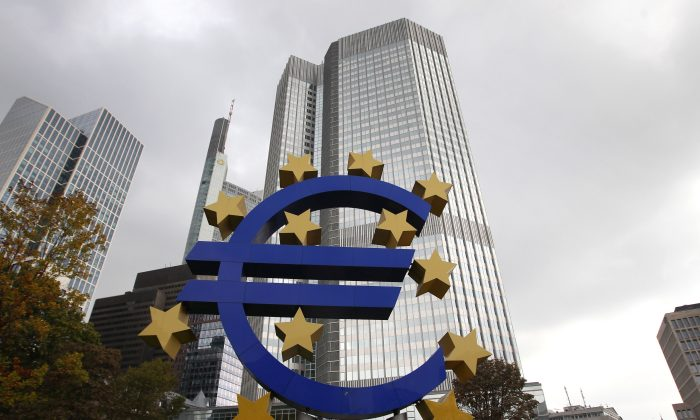 The EURO logo is pictured in front of the European Central Bank (ECB) in Frankfurt/Main, Germany, on Oct. 26, 2014. (Daniel Roland/AFP/Getty Images)