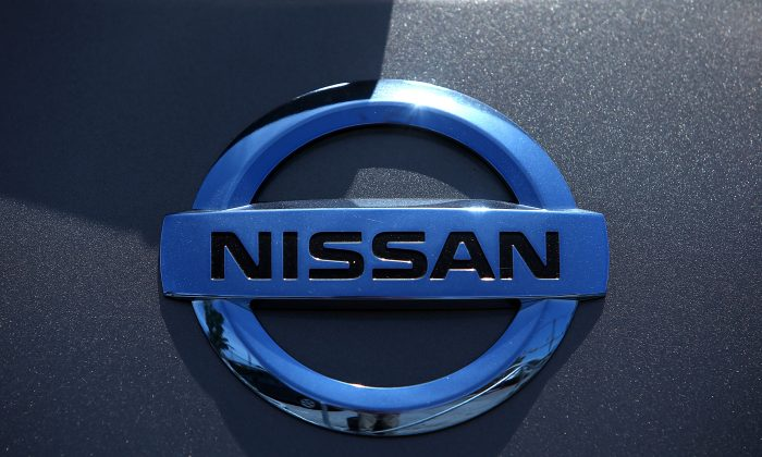The Nissan logo is displayed on a brand new Nissan car at Nissan Marin on May 1, 2014, in San Rafael, California. (Justin Sullivan/Getty Images)