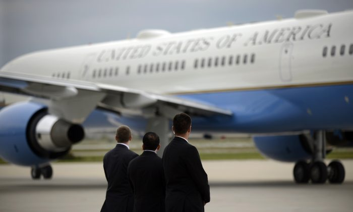 Members of the Secret Service watch as Air Force One taxies on the runway before leaving the Gary/Chicago International Airport in Gary, Ind., on Oct. 2, 2014. In the space of just a few months, the reputations and approval ratings of the Centers for Disease Control and Prevention, Secret Service, as well as the Veterans Administration, have been seen a decline. (AP Photo/Paul Beaty)