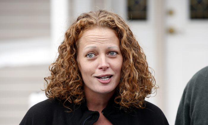 Nurse Kaci Hickox speaks to reporters outside their home, Friday, Oct. 31, 2014, in Fort Kent, Maine. A Maine judge gave Hickox the OK to go wherever she pleases, handing state officials a defeat Friday in their bid to restrict her movements as a precaution against Ebola. (AP Photo/Robert F. Bukaty)