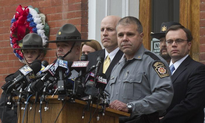 Pennsylvania State Police Lt. Col. George Bivens speaks during a news conference in front of the Pike County Courthouse on Friday, Oct. 31, 2014 in Milford, Pa. following a hearing for accused killer Matthew Frein. (AP Photo/The Scranton Times-Tribune, Michael J. Mullen)