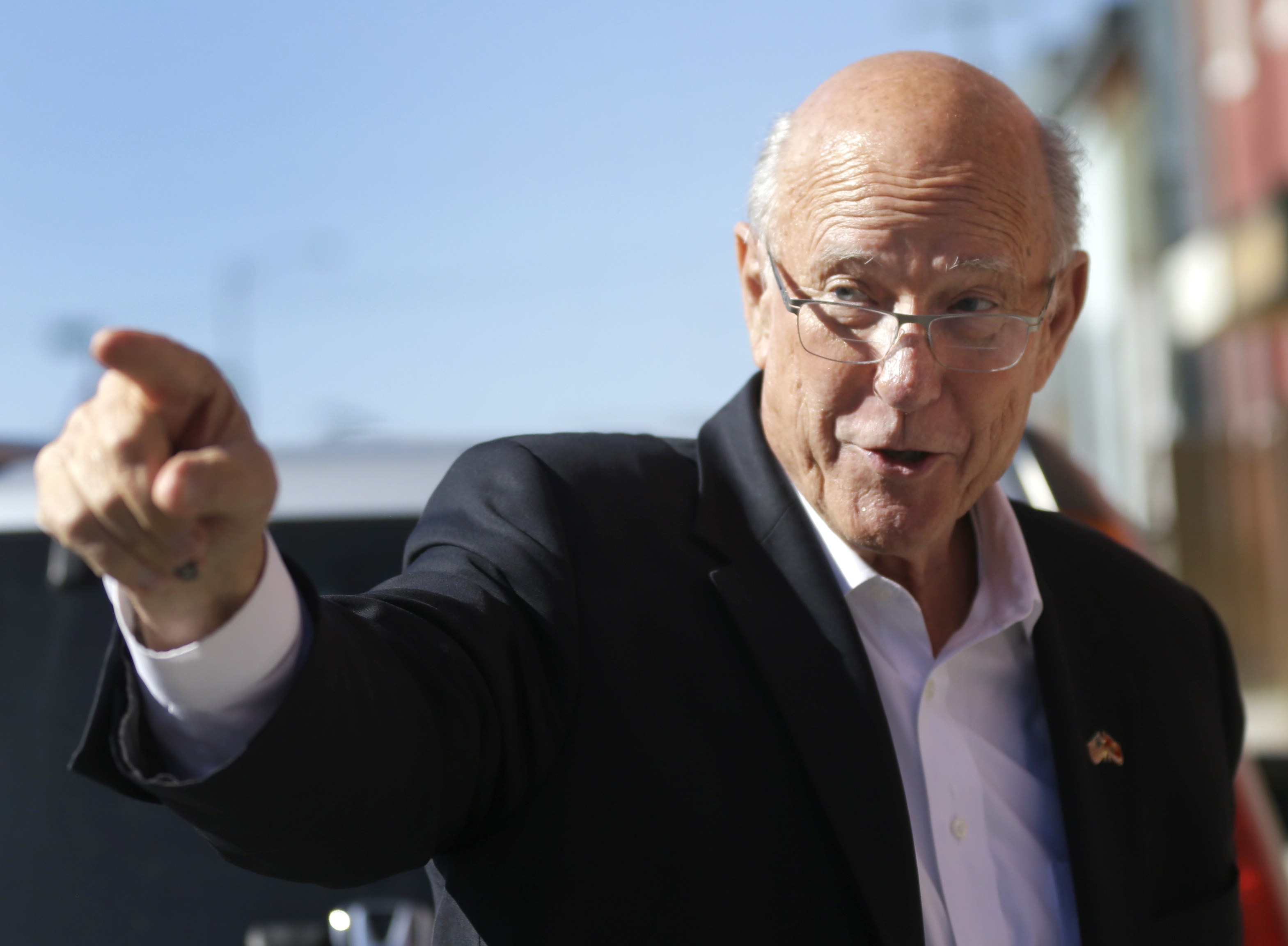 Sen. Pat Roberts (R-Kansas) points to supporters during a campaign stop in Leavenworth