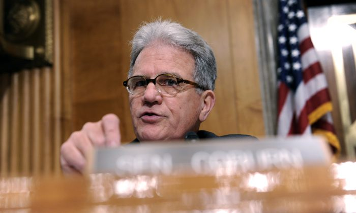 Sen. Tom Coburn, R-Okla. speaks on Capitol Hill in Washington on July 9, 2014. Coburn requested a Government Accountability Office report which showed nearly 60,000 veterans collected more than $3.5 billion in 2013 in military retirement pay, disability benefits from Veterans Affairs and disability checks from Social Security. Coburn said officials should fulfill promises to veterans, but work to streamline duplicative programs. (AP Photo/Susan Walsh)