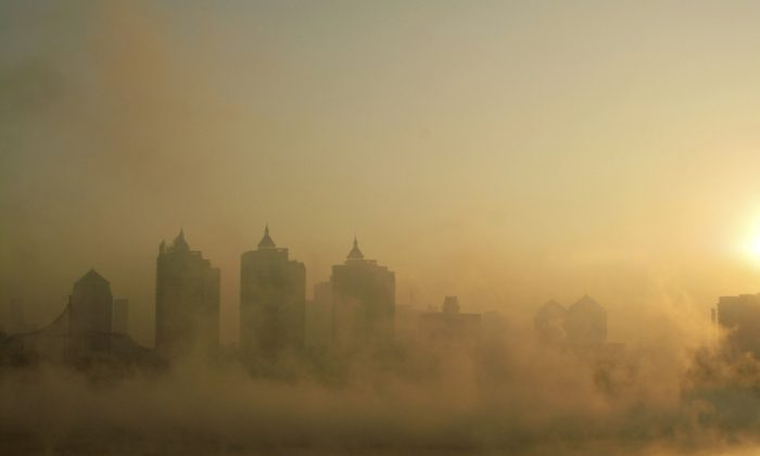 A ship sails up the Huangpu River under a hazy sky in Shanghai on Jan. 10, 2012. Forty-two loan underwriting companies have declared bankruptcy in the Chinese financial hub. (Peter Parks/AFP/Getty Images)