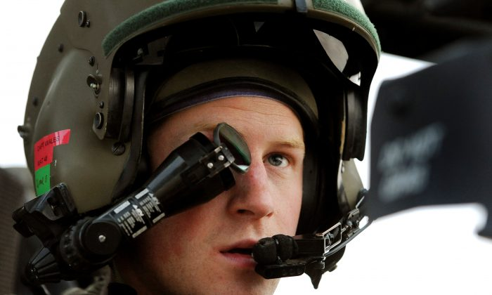 Prince Harry wears his Monocle gunsight, as he makes his early morning pre-flight checks on the flight-line, at Camp Bastion southern Afghanistan. (John Stillwell/PA Wire)