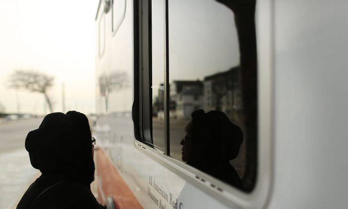 A woman waits for food at the window of Red Cross Disaster Relief truck in the Rockaways following Hurricane Sandy in the Queens borough of New York City on Jan. 25, 2013. (Spencer Platt/Getty Images)