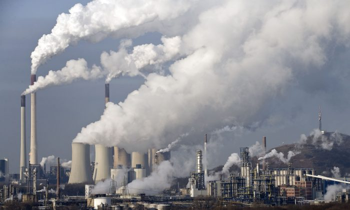Steam and smoke rises from a coal burning power plant in Gelsenkirchen, Germany, on Dec. 16, 2009. (AP Photo/Martin Meissner)