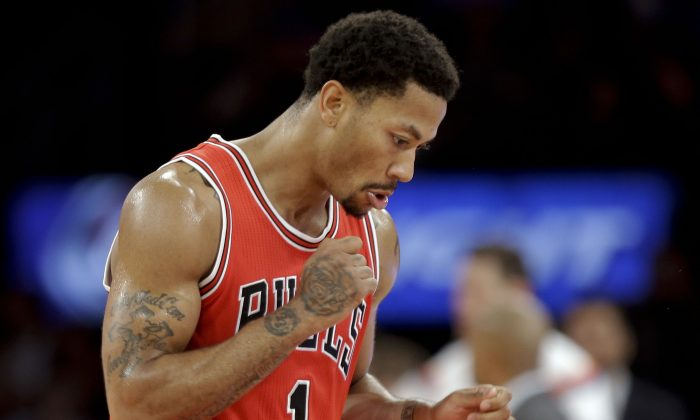 Chicago Bulls' Derrick Rose (1) reacts to a play during the second half of an NBA basketball game against the New York Knicks, Wednesday, Oct. 29, 2014, in New York. (AP Photo/Frank Franklin II)