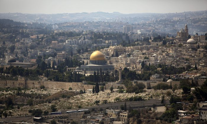 The Dome of the Rock Mosque in the Al Aqsa Mosque compound, known by the Jews as the Temple Mount, is seen in Jerusalem's Old City on Sept. 9, 2013. (AP Photo/Sebastian Scheiner)